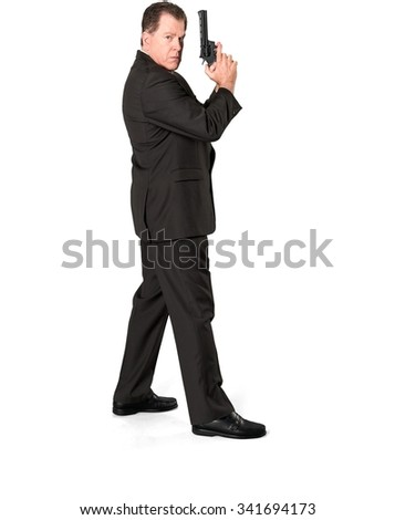 Serious Caucasian elderly man with short medium brown hair in business formal outfit holding handgun - Isolated