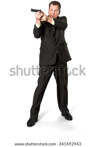 Serious Caucasian elderly man with short medium brown hair in business formal outfit using handgun - Isolated