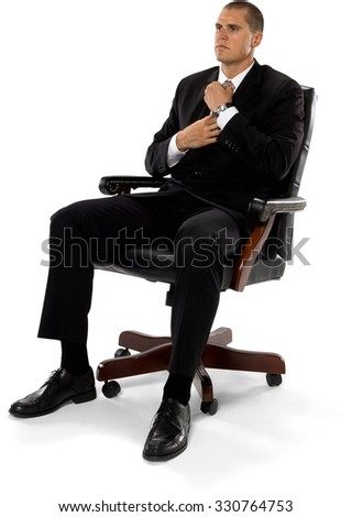 serious caucasian man with short medium brown hair in business formal outfit using office chair - Office Chair For Short Person