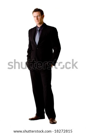 serious looking caucasian man in suit and tie with hand in the pocket