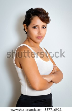Serious woman with arms folded