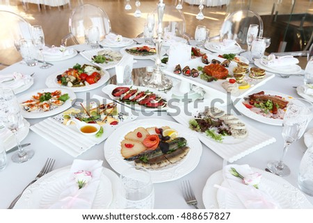 Served banquet table with dishes in restaurant