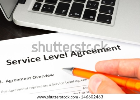 Service Level Agreement Contract Form with Hand and Pen