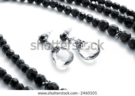 Set black necklace with earring on white background
