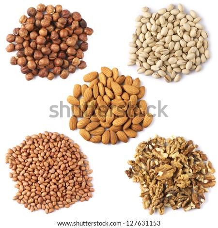 Set of assorted dried nuts isolated on white background.
