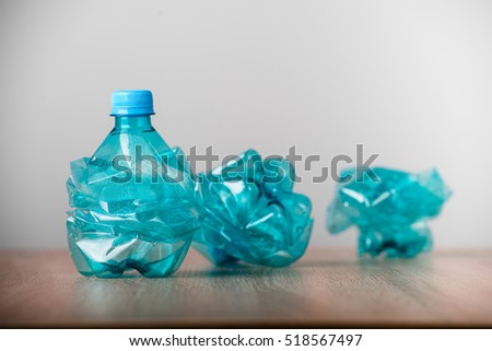 set of blue empty plastic water bottles
