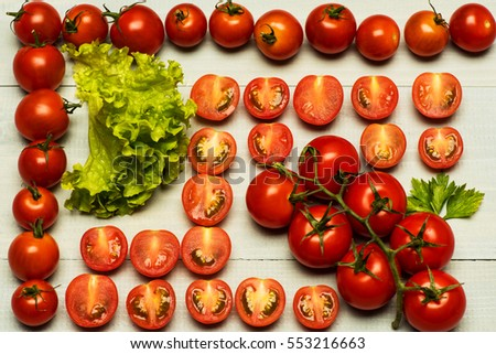 set of cherry tomatoes with parsley and lettuce on white vintage wooden background