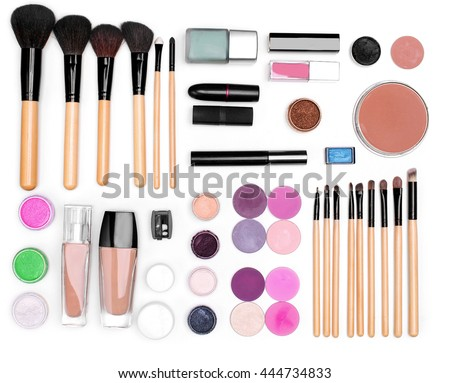 set of cosmetics: eye shadow, lipstick, mascara, powder, lip pencil, Foundation, makeup brushes. top view