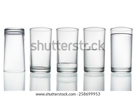 set of glasses filled with water on white background.