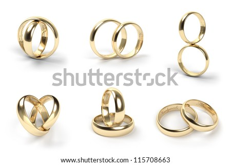 Set of gold wedding rings engraved with the text Newlyweds