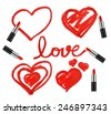 Set of lipsticks and heart shapes on white background - stock photo
