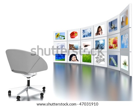 Set of monitors with static colourful and bright images and office armchair
