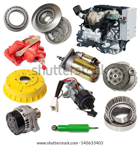 Set of motor and few automotive parts. Isolated over white with shadows