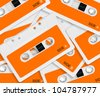 set of orange audio cassettes background. - stock photo