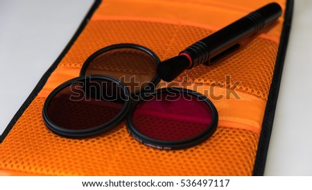 set of photo filters and the brush and case