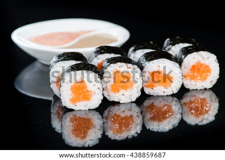 Set of traditional japanese  food sushi on a dark background. Asian food frame. Dinner party