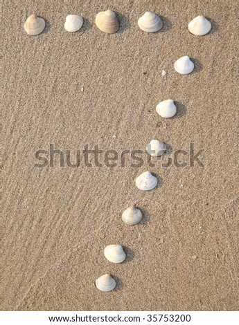 seven digit symbol from shells in a sand