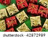 Several christmas gifts on green background - stock photo