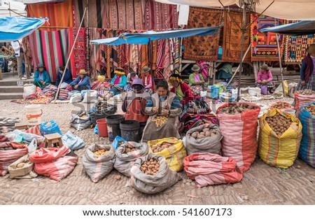 Several female market vendors at stalls selling potatoes on local market at Plaza Constitucion in Taray, Peru. Oct 2nd 2016