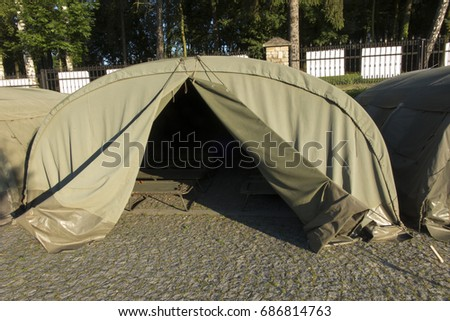 several large military tents on the paved area as a c& for youth & Several Large Military Tents On Paved Stock Photo 687523660 ...