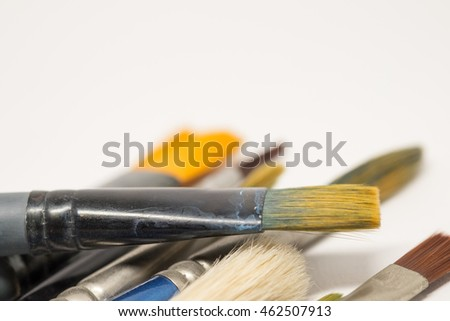 Several paintbrushes on a white background.