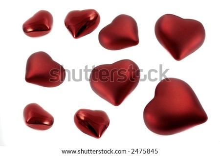 Several red hearts isolated over a white background