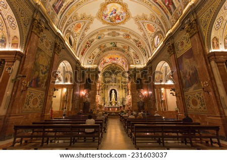 SEVILLE, SPAIN - OCTOBER 29, 2014: The nave of church Basilica de la Macarena with the frescoes by Rafael Rodrguez (1949) in neobaroque style.