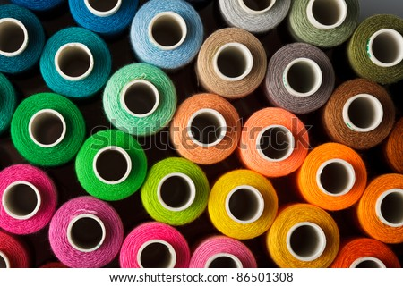 Sewing threads multicolored background closeup