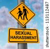 Sexual harassment and sex abuse with a yellow street or highway sign on a blue sky with a woman victim and a man bullying icon in the process of a physical assault at the workplace or in private. - stock photo