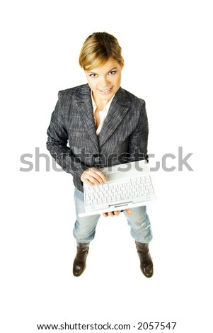 Sexy blond business woman posing with laptop computer on white background