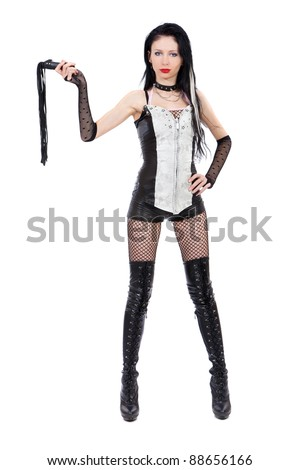 Sexy domina is holding a whip isolated on a white background