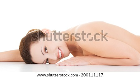 Sexy fit naked woman with healthy clean skin lying down.