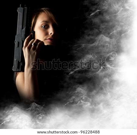 Sexy girl holding gun with smoke