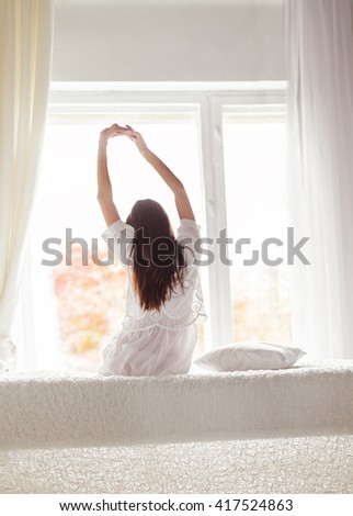 sexy girl in the morning in bed stretching