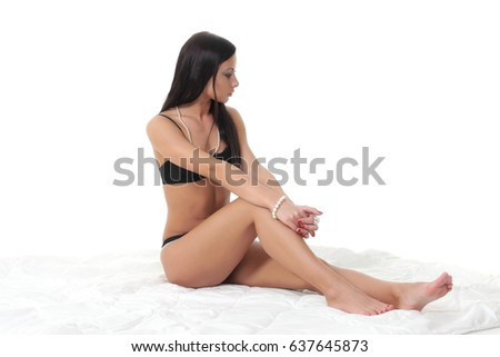 naked black guy sitting on bed