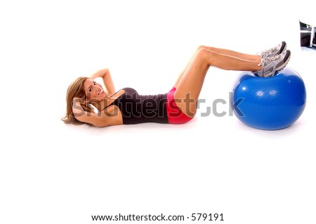 Sexy latina fitness instructor working out with a medicine ball