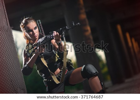 sexy military armed girl with the weapon, sniper