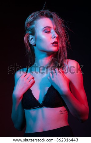 sexy model girl posing in underwear in studio with color gels color filters on foreground. Beautiful female. Colorful beauty fashion shoot  portrait. Blue and red color filters gel
