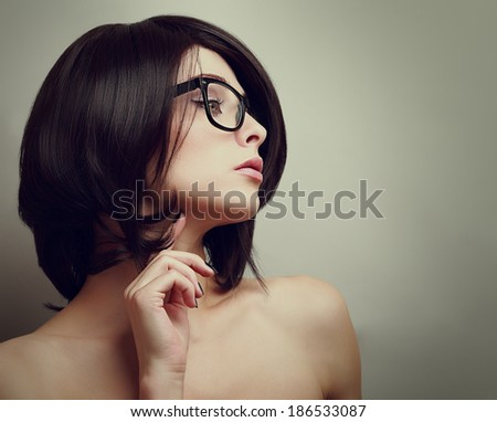 Sexy profile of thinking woman in glasses. Closeup vintage portrait