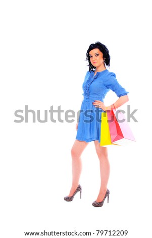 Sexy shopping girl isolated over white background
