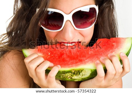 Sexy woman eating watermelon - summer concept