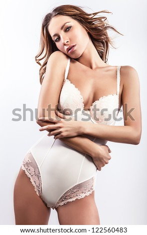 Sexy woman in swimsuit pose in studio.