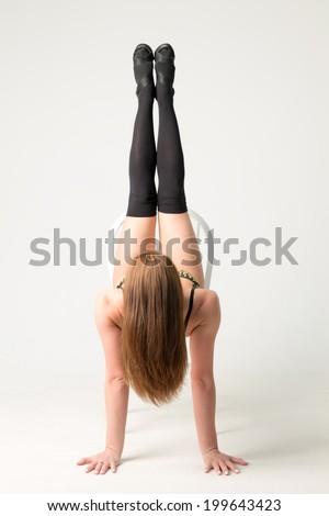 girl lying on back on chair stock photo 199643450
