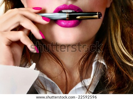 Sexy young pretty woman / model / girl / student / businesswoman / secretary with pink lips, vintage / retro is holding a pen in her lips / seductive - closeup