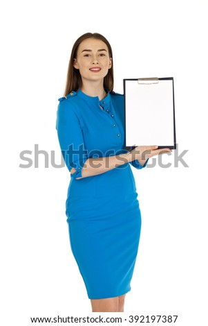 Sexy young woman in blue dress, Caucasian brunette show with clipboard, isolated on white background