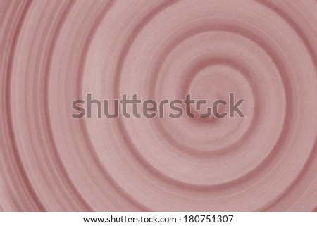 Shades of pink spiral for use as background with copy space.