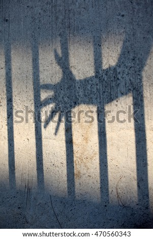 shadow of hand in jail