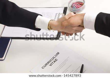 shaking hands with manager at job interview closeup