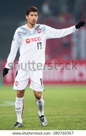 SHANGHAI-CHINA FEBRUARY 09:Tanaboon Kesarat of Muangthong Utd in action during The AFC Champions League 2016 Playoff Shanghai SIPG and Muangthong Utd at Shanghai Stadium on Feb 09,2016 in China