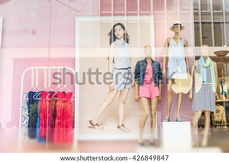 Shanghai, China - on May 11, 2016:shopping street Clothing display window in Nanjing Road?Nanjing Road is the main shopping street in Shanghai and one of the world's busiest commercial streets.